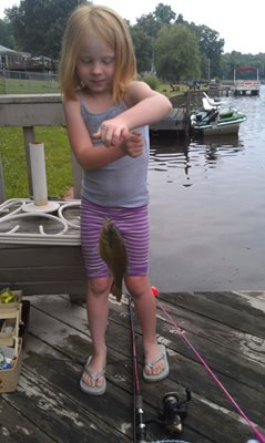 Emma and her giant catch. Bet daddy baited her hook.